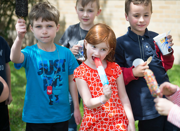 JOED VIERA/STAFF PHOTOGRAPHER-Pendelton, NY- DeSales first graders enjoy some treats from Chilly Billy's Ice Cream Truck.