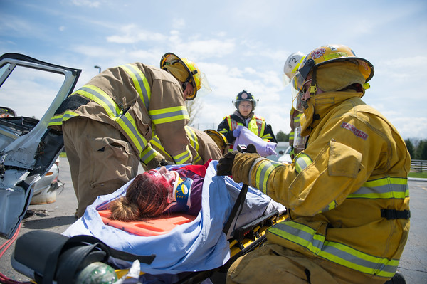 JOED VIERA/STAFF PHOTOGRAPHER-Barker, NY- Barker firefighters provide medical attention during a safety demonstration at Barker High School.