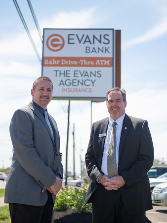 JOED VIERA/STAFF PHOTOGRAPHER-Lockport, NY- Branch Manager Nick Mroz and Universal Banker David Clifford at Evans Bank.