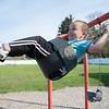 JOED VIERA/STAFF PHOTOGRAPHER-Lockport, NY-EJ Ubiles Jr. smiles on the swings at Dolan Park.