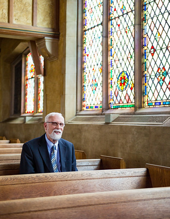 JOED VIERA/STAFF PHOTOGRAPHER-Lockport, NY- Rev. Dr. Duane Priset sits at Emmanuel United Methodist Church.