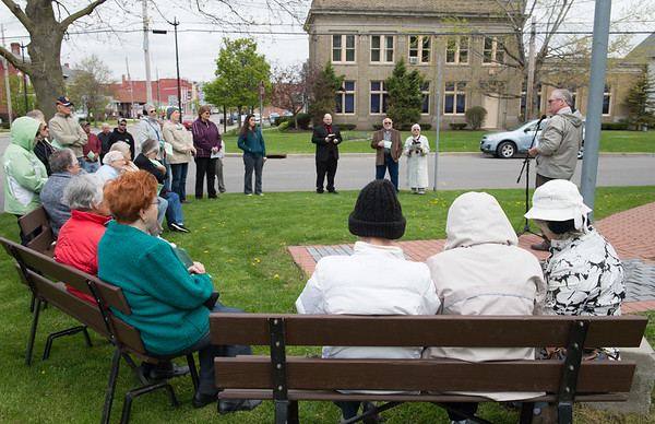 JOED VIERA/STAFF PHOTOGRAPHER-Middleport, NY- Attendees participate in the National Day of Prayer ceremony that took place a Veterans Memorial Park.