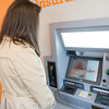 JOED VIERA/STAFF PHOTOGRAPHER-Lockport, NY- A woman tries out the ITM machine at Evans Bank.