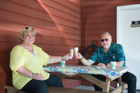 JOED VIERA/STAFF PHOTOGRAPHER-Wilson, NY-Marty and Douglas Westerburg stop by Brownie's ice cream stand for a couple of cones on their way back to Sodas Point in celebration of their 13th wedding anniversary.
