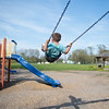 JOED VIERA/STAFF PHOTOGRAPHER-Lockport, NY-EJ Ubiles Jr. plays on the swings at Dolan Park.