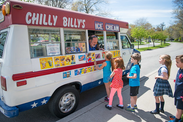 JOED VIERA/STAFF PHOTOGRAPHER-Pendelton, NY- DeSales first graders line up for Chilly Billy's Ice Cream Truck.