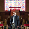 JOED VIERA/STAFF PHOTOGRAPHER-Lockport, NY- Rev. Dr. Duane Priset stands between the pews at Emmanuel United Methodist Church.