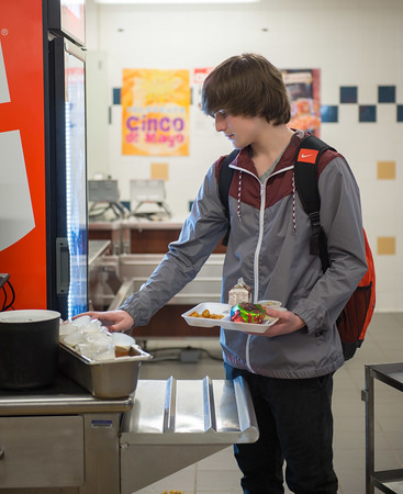 JOED VIERA/STAFF PHOTOGRAPHER-Lockport, NY- Cameron Wallace, a sophomore at Lockport High School pays for lunch.