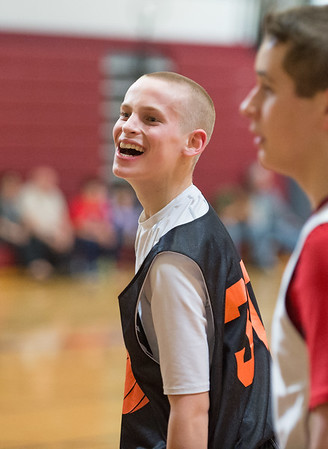 JOED VIERA/STAFF PHOTOGRAPHER-Pendleton NY- Akron High School Unified Sports Team's  10th grader, Nathan Forrestel, 16, smiles after a play in a basketball scrimmage against Starpoint High School.