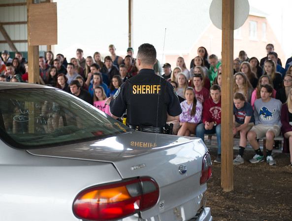 JOED VIERA/STAFF PHOTOGRAPHER-Lockport, NY-Niagara County Sheriffs' Tyler Magliazzo talk to students on the site of a staged accident at the Niagara County Fairgrounds during the safety fair.