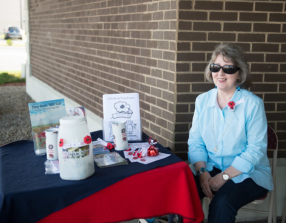 JOED VIERA/STAFF PHOTOGRAPHER-Lockport, NY-Diane Fischer sells Poppies for the VFW Buddy Poppy Program outside of First Niagara on Transit Road.