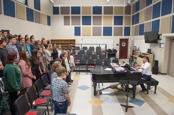 JOED VIERA/STAFF PHOTOGRAPHER-Lockport, NY- Rob Pacillo leads students that will be joining choir alumni during a rehearsal at Lockport High School.