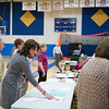 JOED VIERA/STAFF PHOTOGRAPHER-Lockport, NY- Michelle Bradley puts out informational flyers during the  school board and budget vote at Lockport High School.