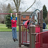 JOED VIERA/STAFF PHOTOGRAPHER-Lockport, NY- Chase Floss 7 hangs from the playground at Day Road Park.