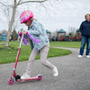 JOED VIERA/STAFF PHOTOGRAPHER-Lockport, NY- Trista Hayden watches her daughter Quinn, 5, rides a scooter at Day Road Park.