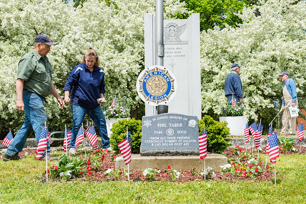 JOED VIERA/STAFF PHOTOGRAPHER-Lockport, NY- Bill Burnett helps spruce up the Veterans Memorial on S Transit along with other American Legion Members.