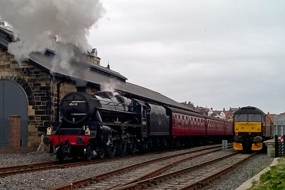 Under darkening skies, 45428 'Bishop Eric Treacy' departs Whitby with 1T15 1400 to Pickering. Stabled in the adjacent platform is 47854 at the head of 1Z36 1630 return SRPS Railtours charter to Gourock, which it would work as far as Battersby (28/05/2016)