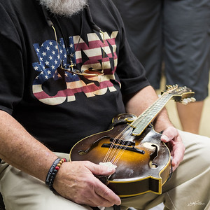 Bill Fortney holding Ricky Scaggs' mandolin at Ricky Scaggs, Joe McNally lighting workshop, Dury's Camera Store