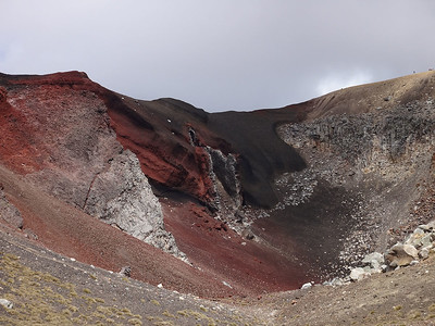 A giant and mysterious vent issues forth from the inner side of the Red Crater. Whom knows what volcanic compounds once flowed from it.