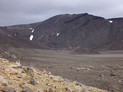 Next, pockets of snow remain here in the vast Central Crater in late summer