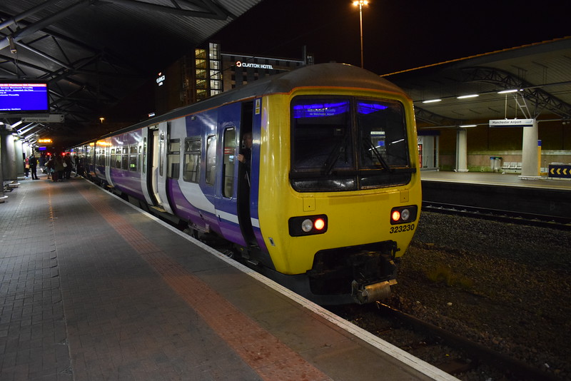Northern Class 323 no. 323230 at Manchester Airport on a non-stop service to Piccadilly.