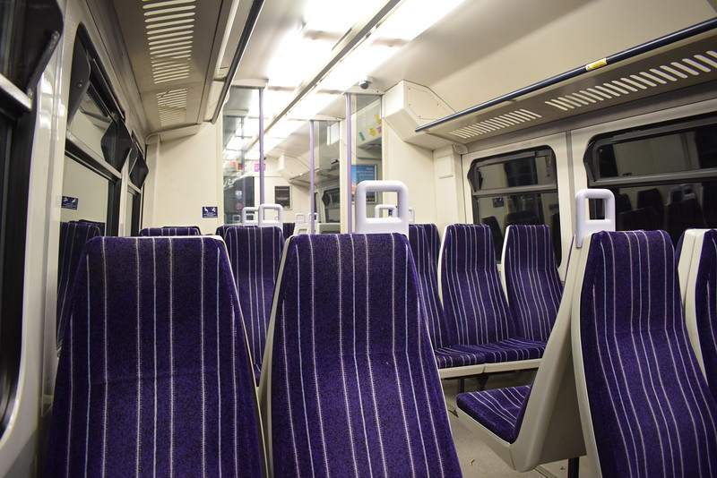 Northern Class 323 no. 323230 interior at Crewe on a non-stop service to Manchester Airport and Piccadilly.