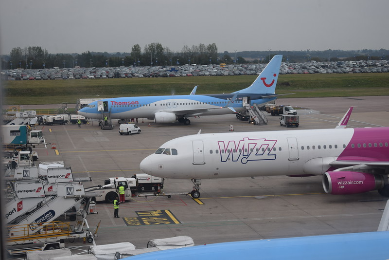 WizzAir Airbus A321 HA-LXC and a Thomson Boeing 737-800 at London Luton Airport.