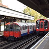 London Underground Piccadilly Line 1973 stock passing Metropolitan Line S8 Stock no. 21076 at Ruislip, showing the difference between the tube and sub-surface train profiles.