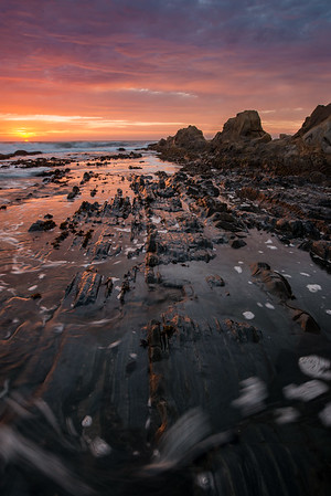 As the sun began to set, the sky started to light up on fire ... just as Escaype predicted. Unfortunately the tide was also coming in and the straiated rocks started to get covered by the rising tide.