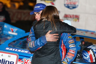 Josh Richards getting a hug from wife Andrea