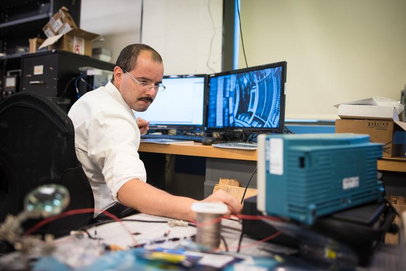 Carlos Cartagena in David Schaffner's physics lab.
