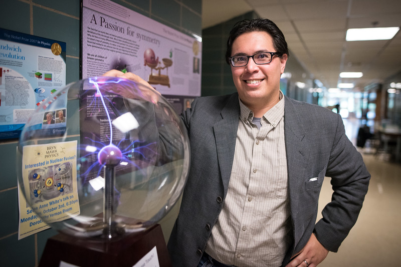 David Schaffner with the plasma globe on display outside of his physics lab.