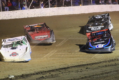 Russ Frohnapfel (45), Billy Staker (7S), Scott Bloomquist (0) and Darrell Lanigan (15)