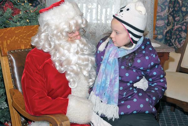 Santa visits historical Ray House