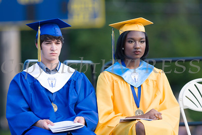 Valedictorian Zachary Siper and Salutatorian Kaila Helm listen to speeches during Newburgh Free Academy''s 151st Commencement Exercises for the graduating Class of 2016 on Academy Field in the City of Newburgh, NY on Thursday, June 23, 2016. Hudson Valley Press/CHUCK STEWART, JR.