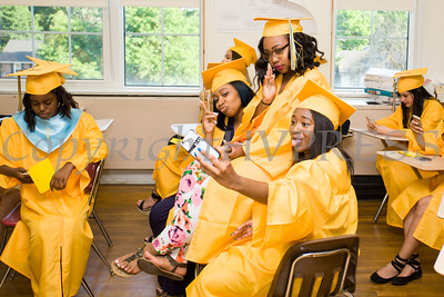 Chelsea Redan, Kyra Phinney and Ashire Riddick take a selfie prior to Newburgh Free Academy's 151st Commencement Exercises for the graduating Class of 2016 on Academy Field in the City of Newburgh, NY on Thursday, June 23, 2016. Hudson Valley Press/CHUCK STEWART, JR.