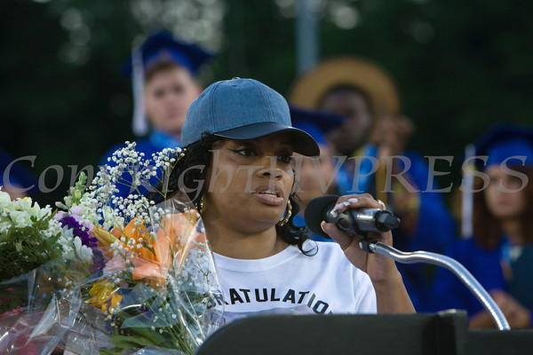 Cathis Johnson accepts a special presentation on behalf of members of Caval Haylett's family made during the Poughkeepsie High School 144th Commencement Exercises for the graduating Class of 2016 on Friday, June 24, 2016 in Poughkeepsie, NY. Hudson Valley Press/CHUCK STEWART, JR.