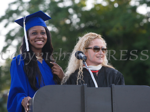 Senior Class Rep. Terralyn Cherry-Brown and Senior Class Advisor Heather Martino present the class gift during the Poughkeepsie High School 144th Commencement Exercises for the graduating Class of 2016 on Friday, June 24, 2016 in Poughkeepsie, NY. Hudson Valley Press/CHUCK STEWART, JR.