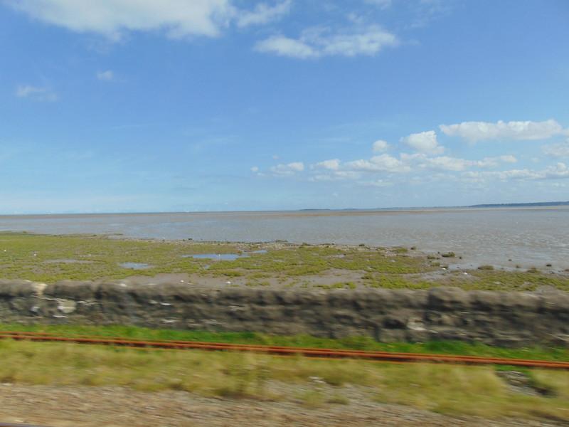 The North Wales Coast Line running along the sea near Rhyl.