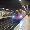 A train of London Underground Metropolitan Line S-stock arrives at Euston Square.
