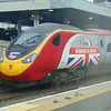 Virgin Trains 'Business is Great' branded Class 390 Pendolino no. 390151 at London Euston.
