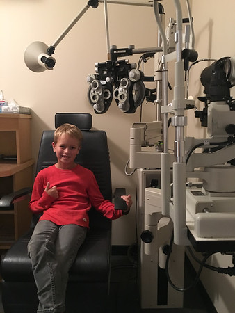Connor getting his 12 week vision re-eval. Eye therapy, his favorite thing in the world.