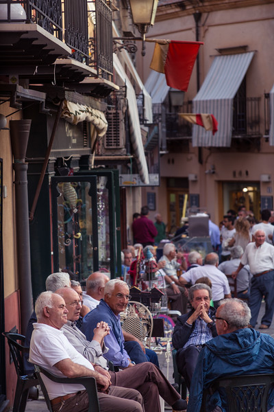 Old boys gather in the square in Castlebueno