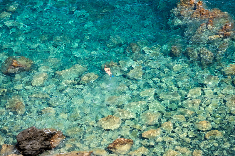 Snorkeler in the crystal clear waters off Malfa