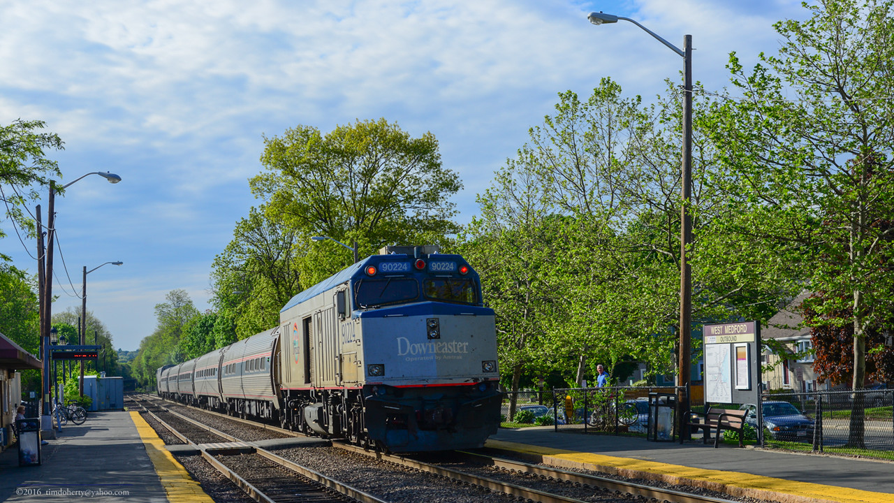 Outbound Downeaster heads back to Maine through West Medford Station on the Lowell Line on May 22, 2016.