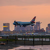 BA flight 215 arrives in Boston just after sunset.