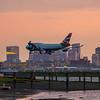 BA flight 215 arrives in Boston just after sunset.