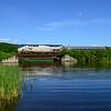 Amtrak's northbound Vermonter crosses a bridge in South Brattleboro on June 18, 2016.