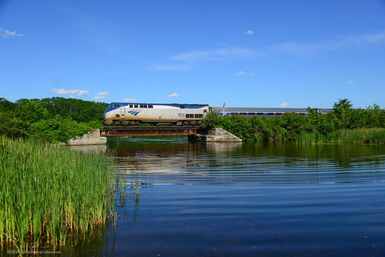 Amtrak's northbound Vermonter crosses a bridge in South Brattleboro on June 18, 2016.