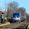 Amtrak 142 takes the 5pm Downeaster thru West Medford on April 10, 2016.